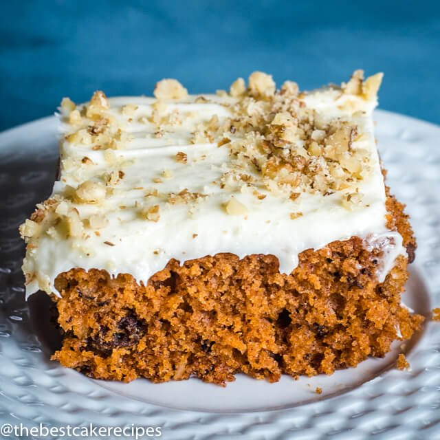 piece of spice cake with nuts and frosting on a plate