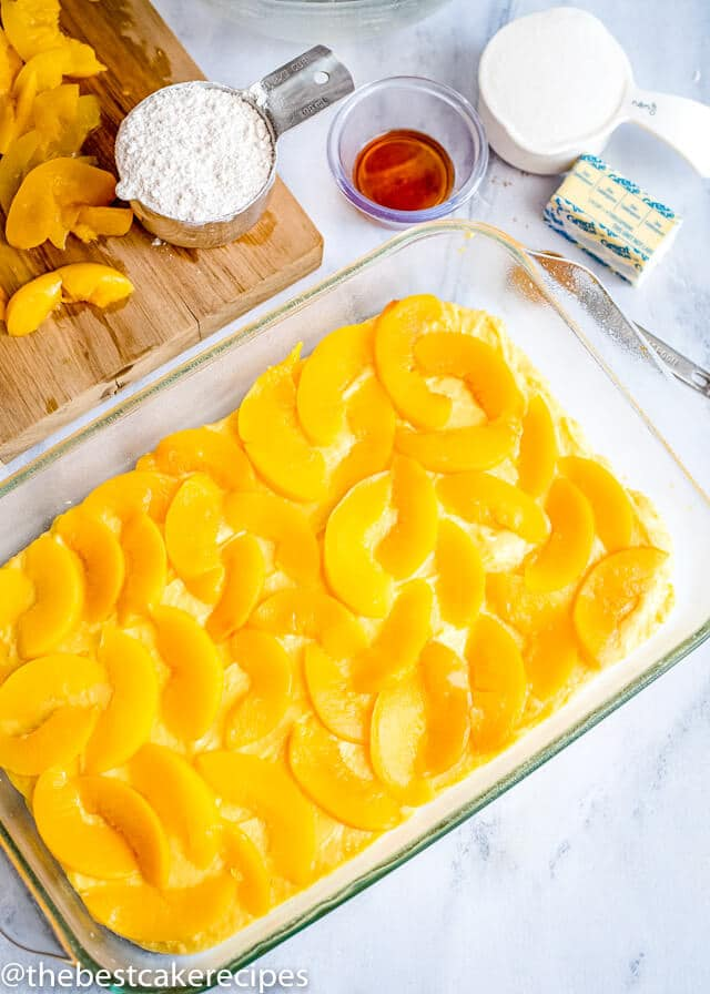 process shot of peach cake with fresh peaches
