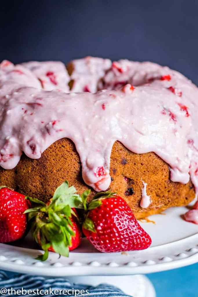 Strawberry Bundt Cake with glaze on a cake plate