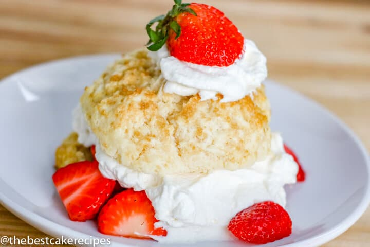 Homemade Strawberry Shortcakes with whipped cream on a plate