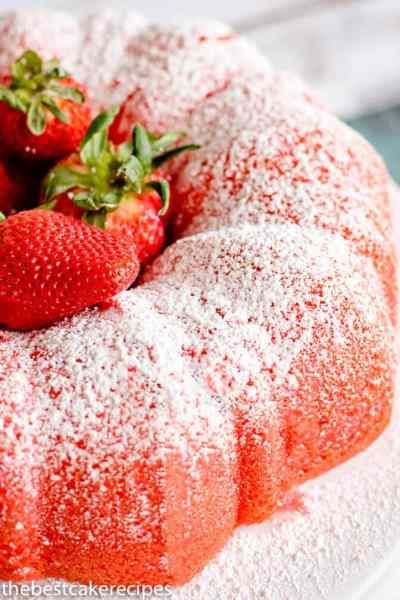 Filled Strawberry Bundt Cake with fresh strawberries