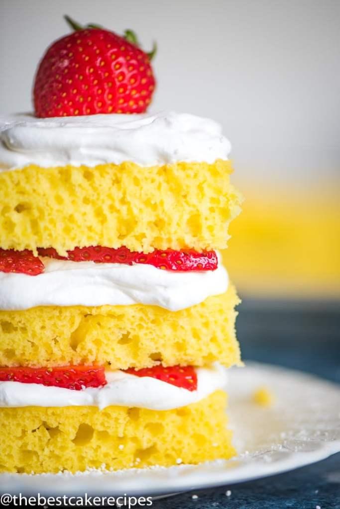closeup of lemon cake with strawberries