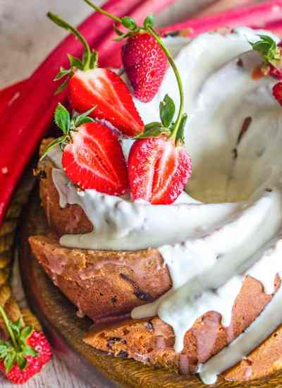 Strawberry Rhubarb Bundt Cake with glaze and strawberries