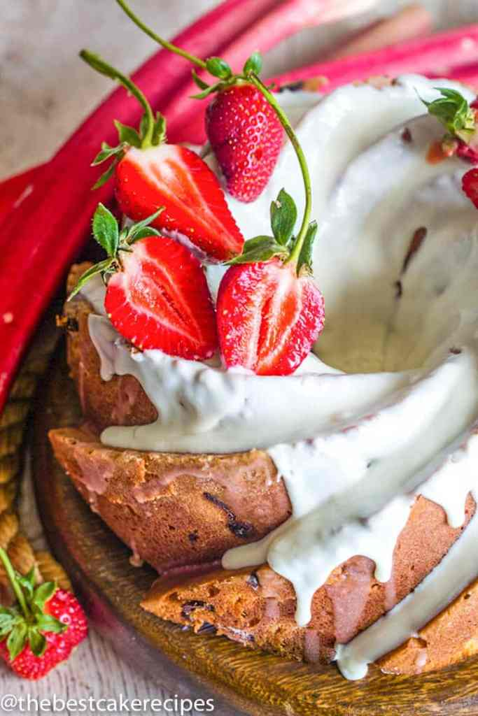 Strawberry Rhubarb Bundt Cake with glaze and strawberries
