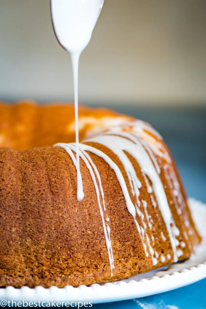 glaze drizzling over a bundt cake
