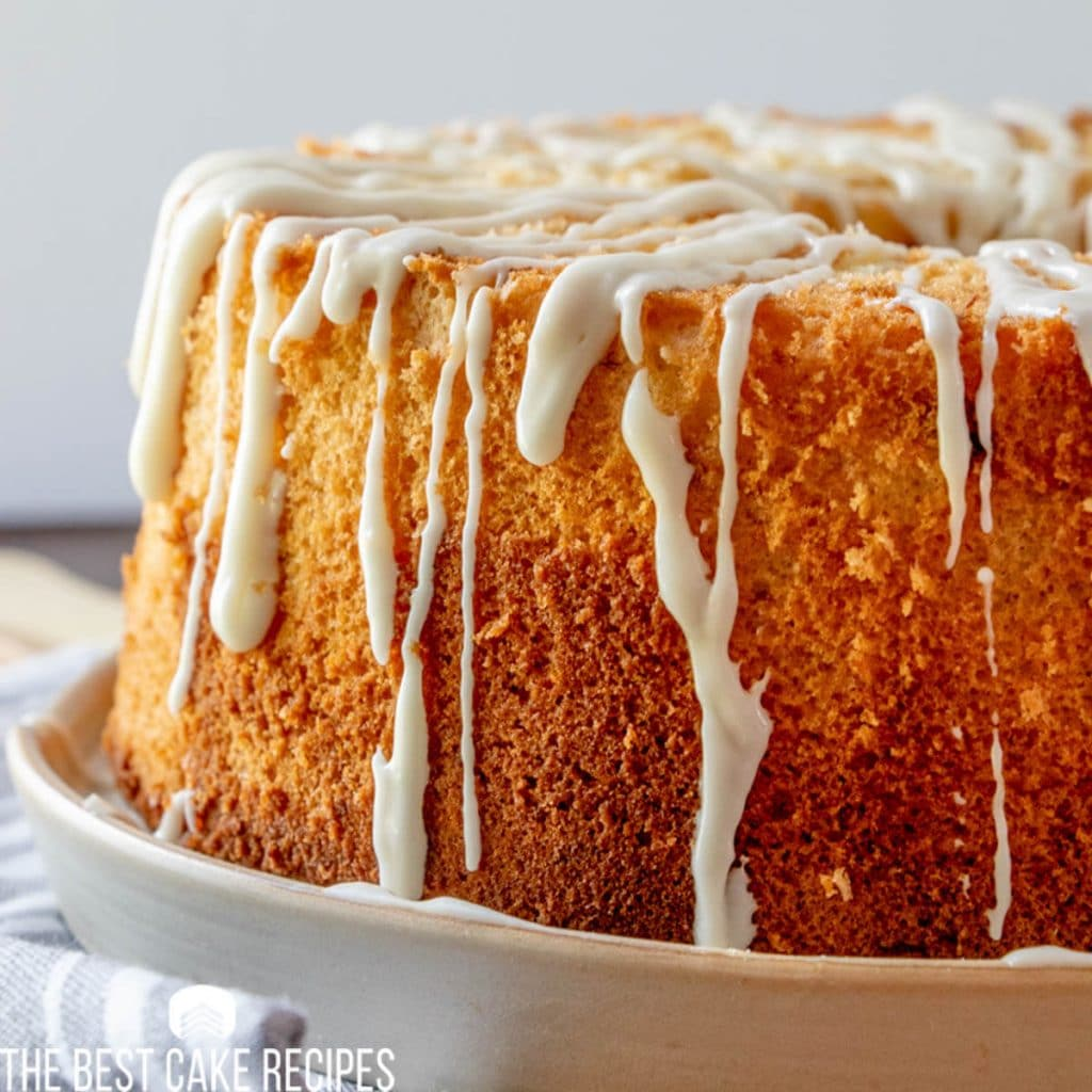 Banana Chiffon Cake with drizzle on a cake plate