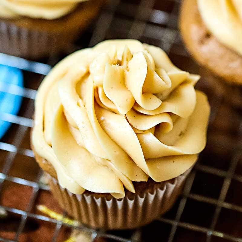 caramel frosting piled on a cupcake