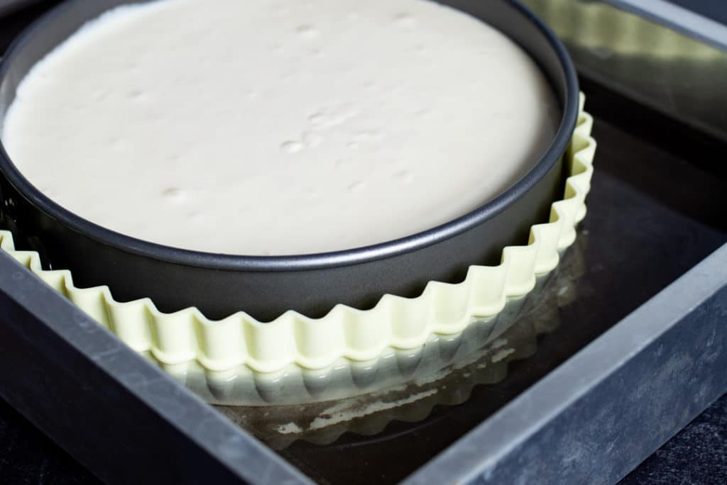 unbaked cheesecake in a water bath