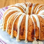 drizzled Jewish Apple Cake on a cake plate