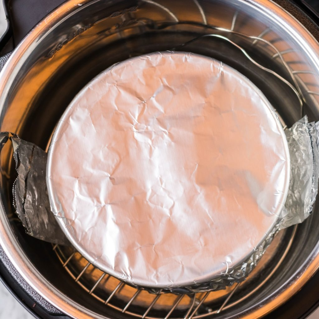 instant pot cheesecake in a foil covered pan