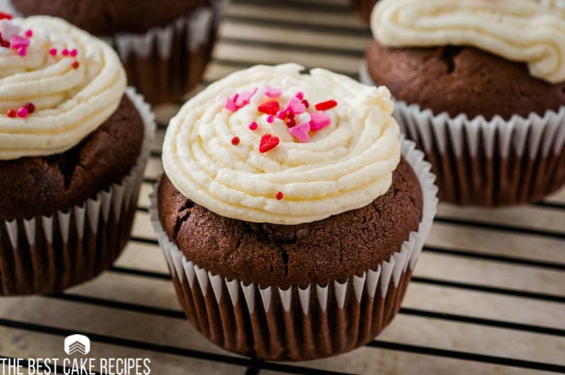 A close up of a chocolate cupcake with frosting