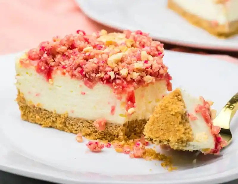 creamy Strawberry Crunch Cheesecake on a plate