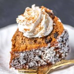 Applesauce Bundt Cake with whipped cream and cinnamon