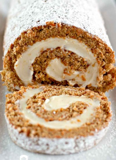carrot cake roll on a plate