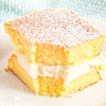 square of Homemade Twinkie Cake with a bite out of it