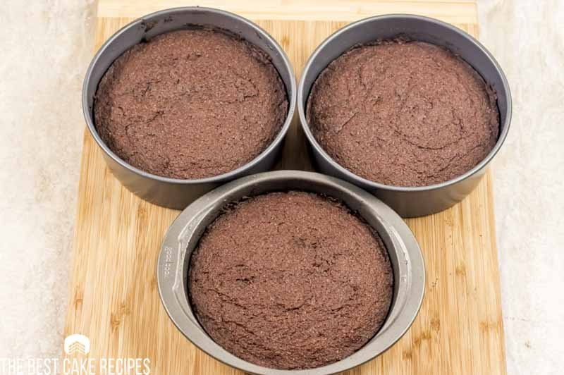 3 baked chocolate cakes in a pan