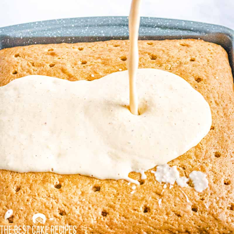pouring eggnog over poke cake