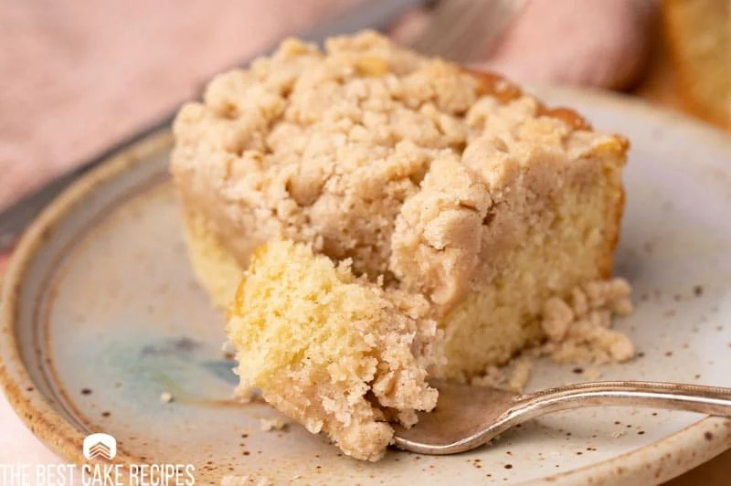 new york crumb cake on a plate with a fork