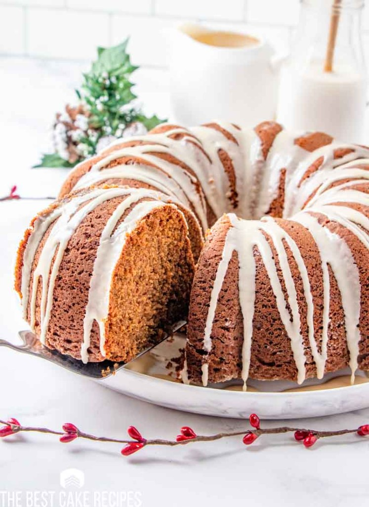 gingerbread bundt cake with one slice on a spatula