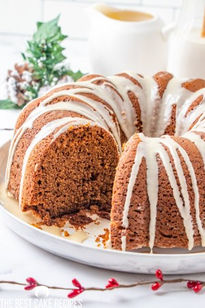 gingerbread bundt cake on a plate with one slice out