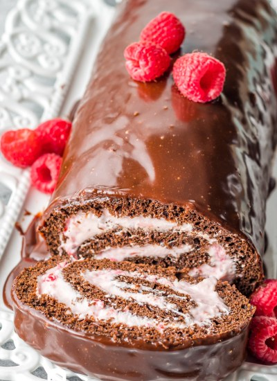 cake roll with chocolate ganache and raspberries