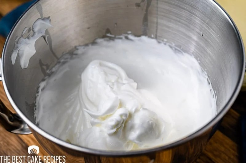 whipped egg whites in a mixing bowl