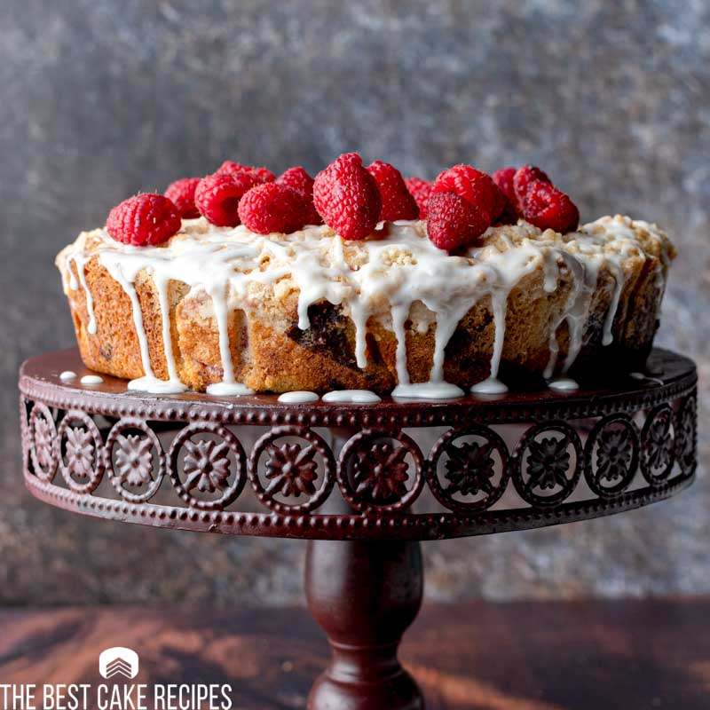 coffee cake with raspberries on top