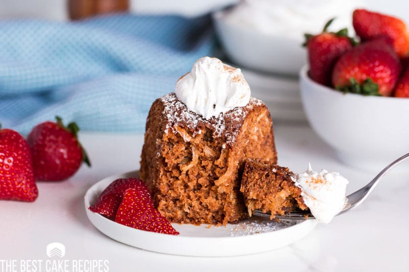 strawberry jam cake with one bite missing