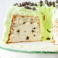 half of a mint chocolate chip angel food cake on a plate