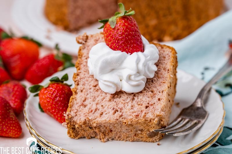 cake sitting on a plate with a strawberry