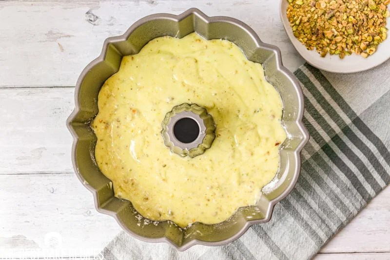 pistachio pudding cake batter in a pan