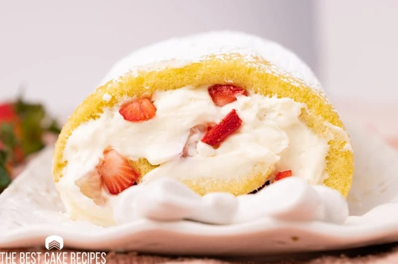 a stuffed cake roll with cream cheese filling and strawberries