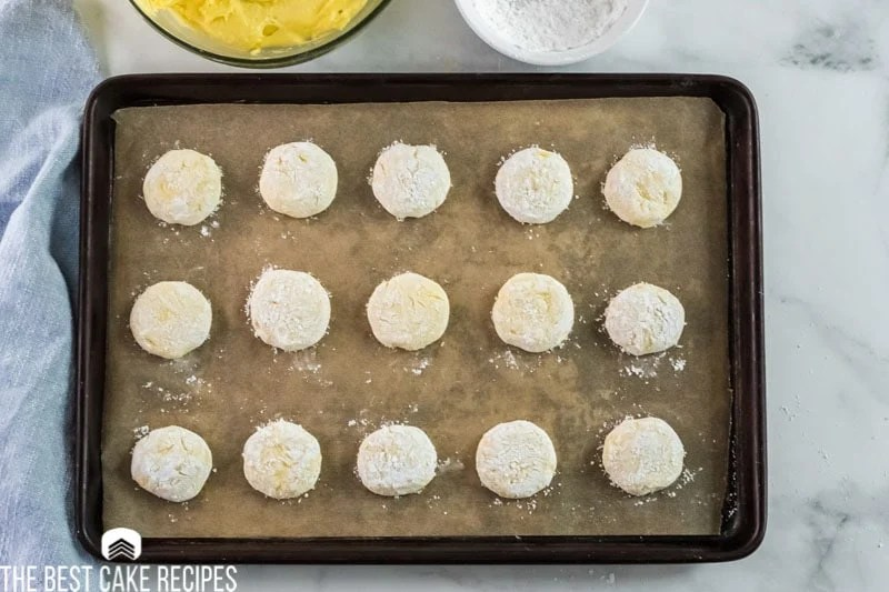 unbaked lemon cookies on a baking sheet