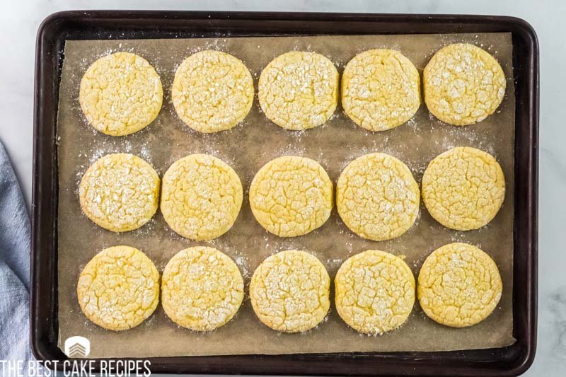 lemon cookies on a parchment paper lined baking sheet