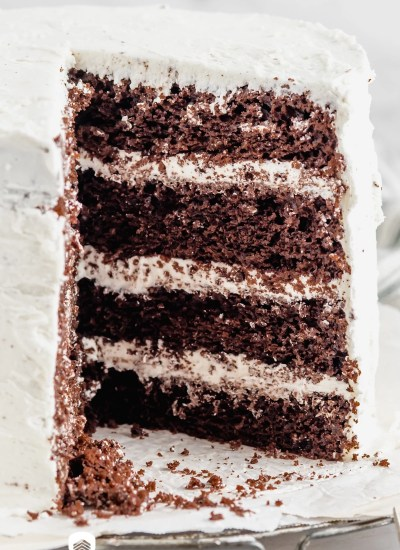 a 4 layer chocolate cake with one slice missing