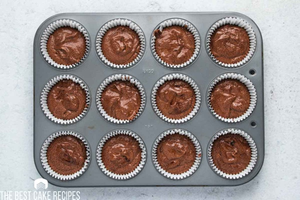 unbaked chocolate cupcakes in a muffin pan