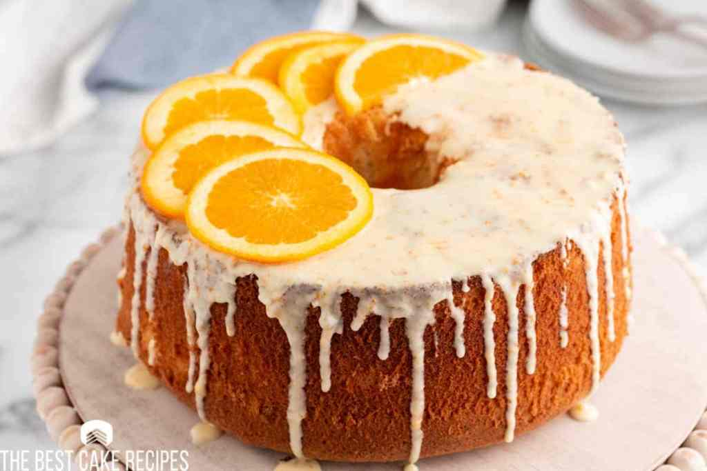 glazed orange chiffon cake on a plate
