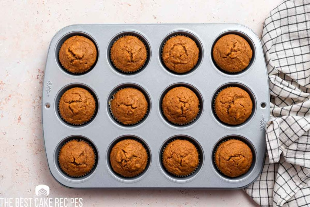 baked pumpkin cupcakes in a muffin pan