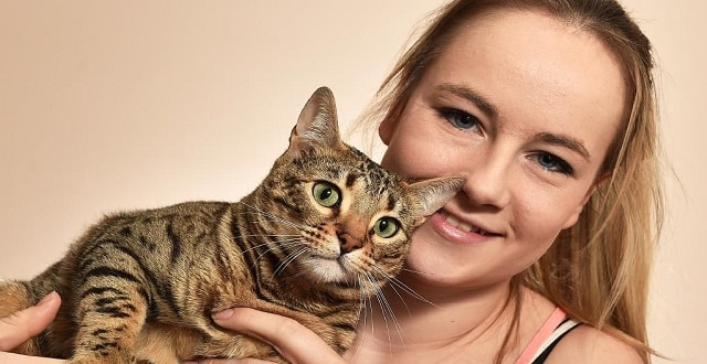 Jayde Harvey adopted Phoebe last year after the cat suffered abuse at the hands of a breeder. Picture: Ellen Smith