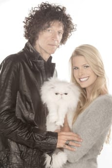 Howard Stern and Beth Ostrosky Stern pose with a kitten.