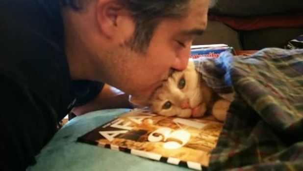 Tigger's dad, Michael Trentadue, gives him a kiss.