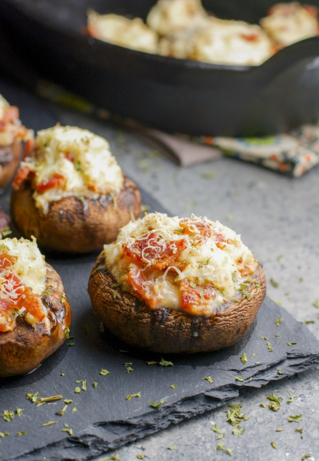 These Crab and Bacon Stuffed Mushrooms are packed with creamy cheese, salty bacon and lumps of crab meat. The perfect low carb, keto, five ingredient appetizer! #keto