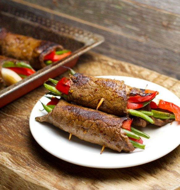 These easy Keto Steak Rolls are loaded with flavor. Flank steak is wrapped around green beans, peppers and onion, just 6 net carbs per serving!