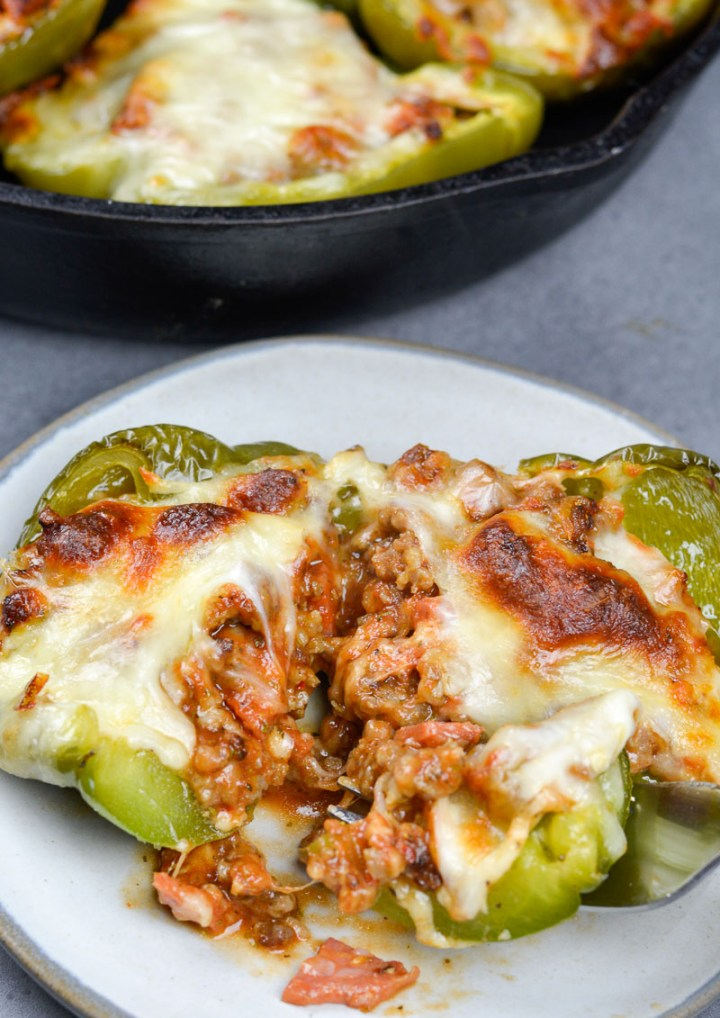 These easy Keto Pizza Stuffed Peppers have less than 5 net carbs per serving and are loaded with pizza flavor!