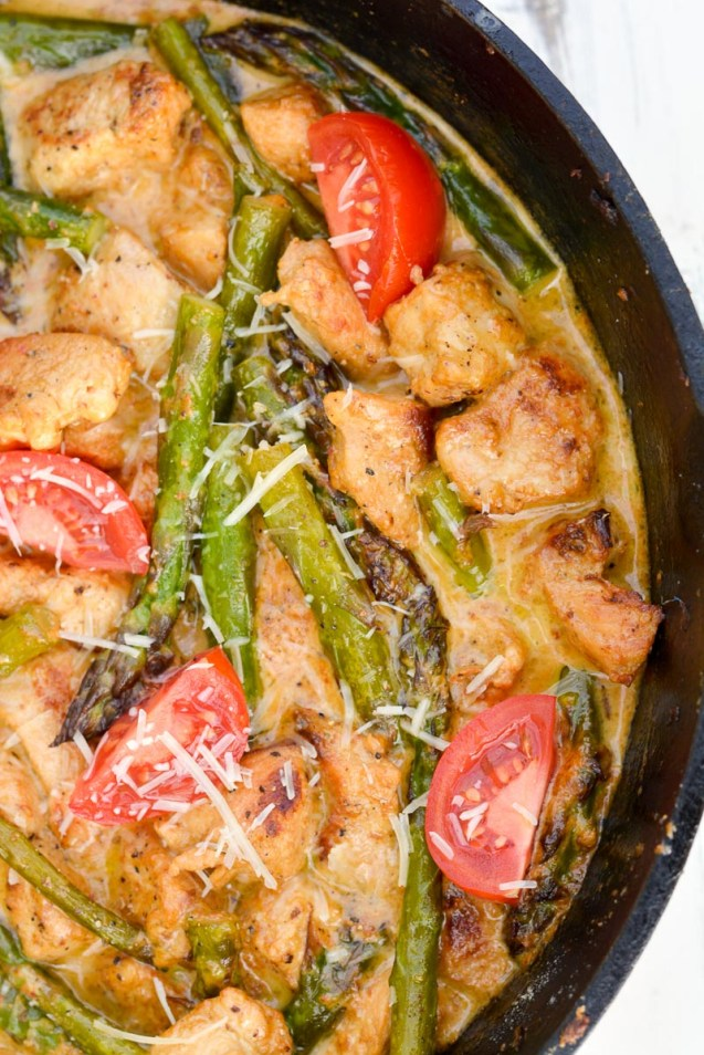 Keto Tuscan Chicken with Asparagus is an easy one pan low carb meal! Packed with seasoned chicken, tender asparagus and a rich parmesan cream sauce this will be a new family favorite!