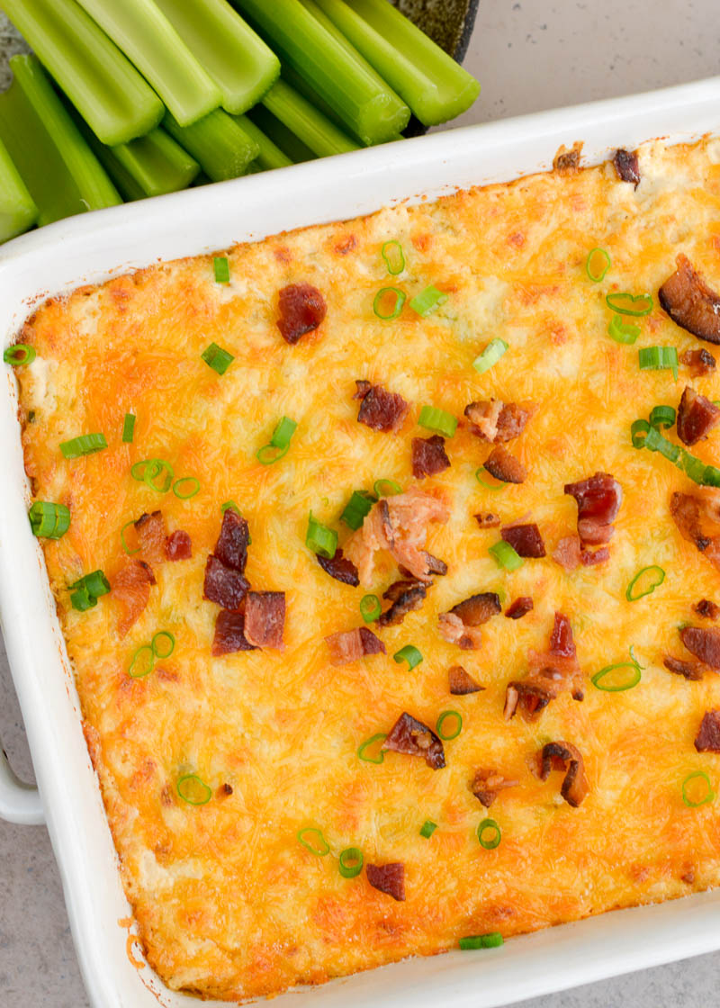 This Cheesy Crab and Bacon Dip is loaded with tender lump crab, crispy bacon, green onions and three kinds of cheese! When paired with crunchy celery sticks this is the perfect low carb game day appetizer!