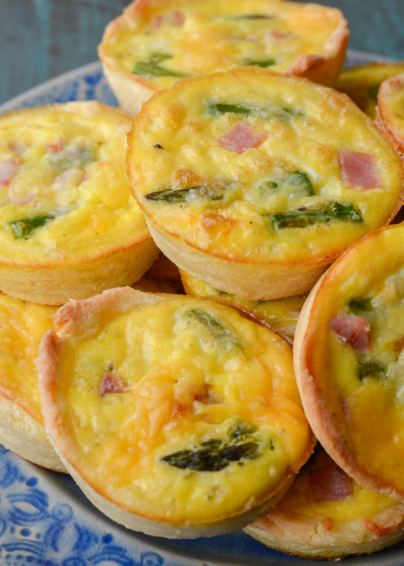 This savory Keto Ham and Cheese Quiche is the perfect low carb brunch recipe! Packed with smoked ham, tender asparagus and sharp cheddar cheese this will be a family favorite!