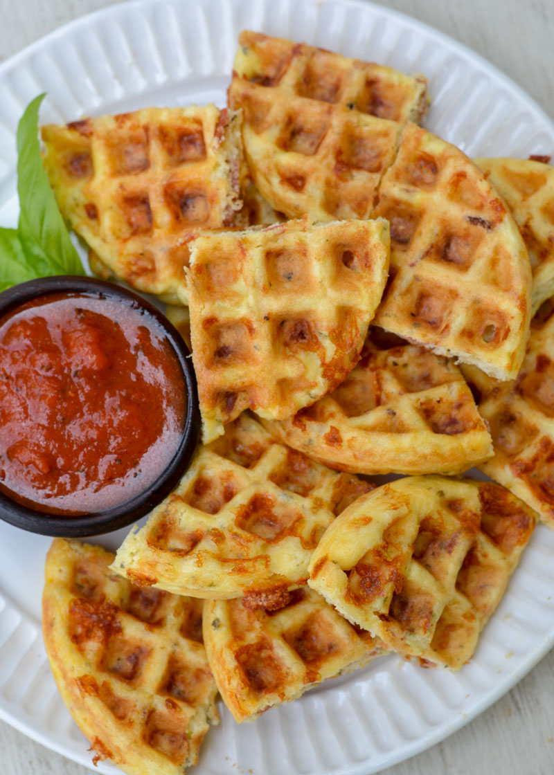 Enjoy these cheesy Pepperoni Pizza Chaffles for just 2 net carbs each!