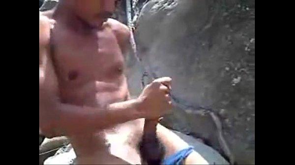Flagrante de punheta na praia