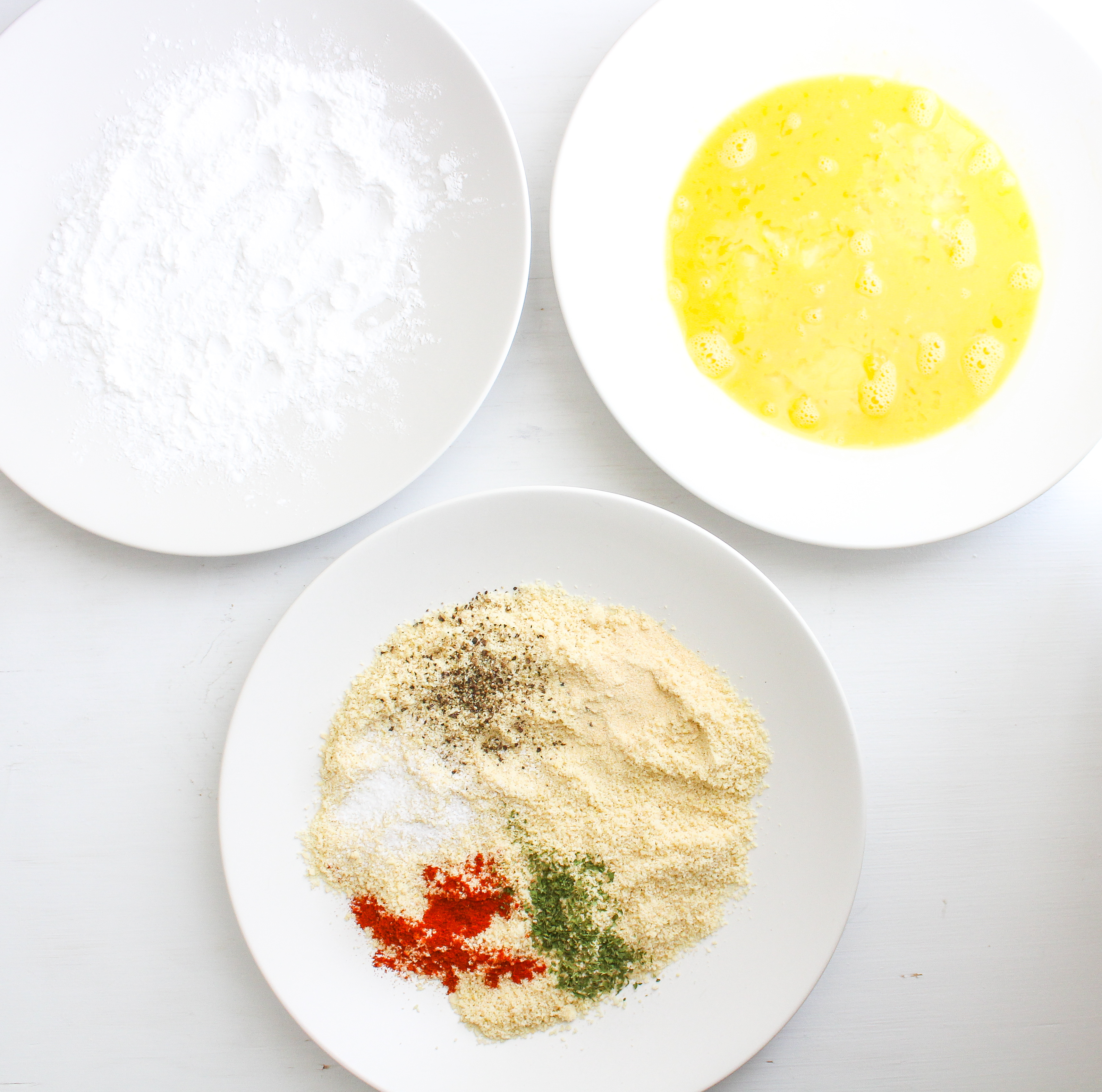 3 shallow plates, one has starch, one has beaten eggs and one has seasoned flour